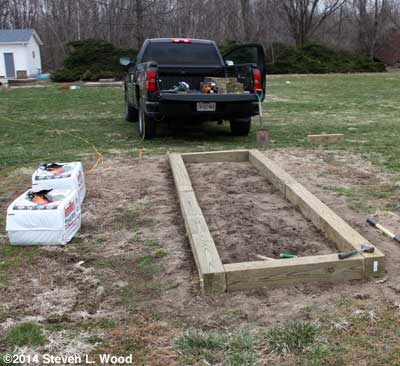 Laying base of raised bed