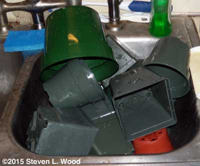 Pots drying in kitchen sink