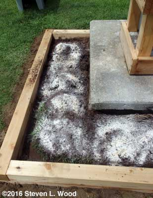 Lime, peat moss, and gypsum spread over clay soil