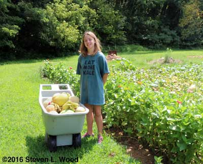 Granddaughter Katherine, melons, and zinnias