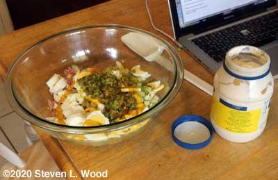 Adding ingredients to mixing bowl