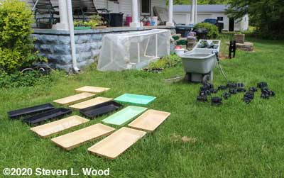 Washing and drying plant trays, pots, and inserts