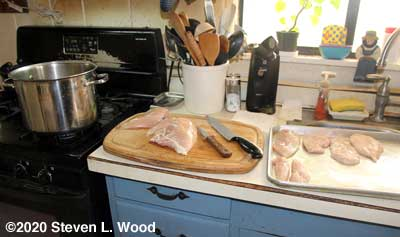Fileting chicken breasts and boiling down carcasses