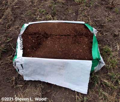 Bale of peat moss opened to catch rain