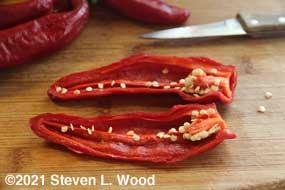 Ripe paprika pepper split open for seed saving