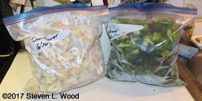 Bags of frozen cauliflower and broccoli