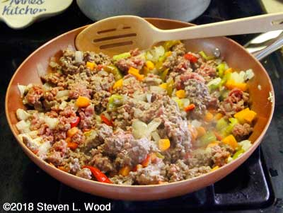 Ground beef added to pan to brown