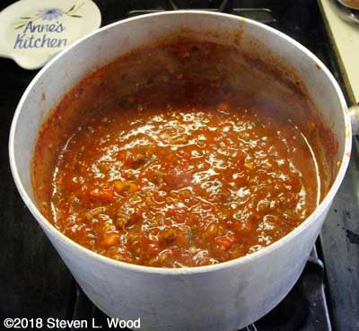 Ingredients combined, thickened, ready to serve over spaghetti noodles