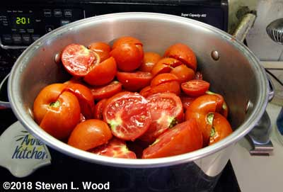 Tomatoes washed and cut and beginning to heat up
