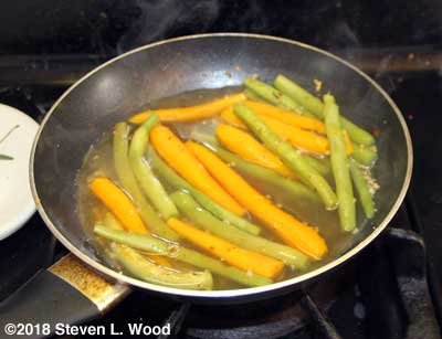 Steaming carrots and green beans