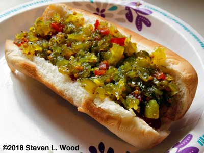 Homemade sweet relish on a hot dog