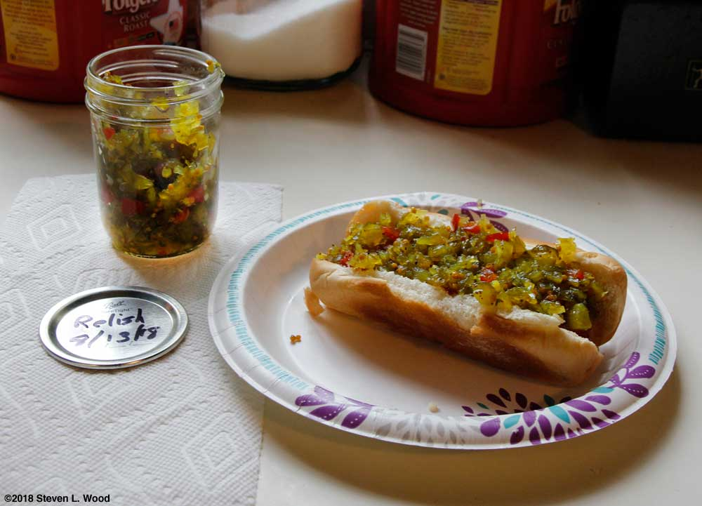Relish jar and hot dog with relish